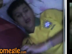 Small Latin boy jerks off his cock before going to sleep