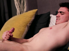Pretty sexy twink hotly jerks off in the bed