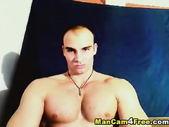 Bald gay is pleasantly waking off huge cock to the camera