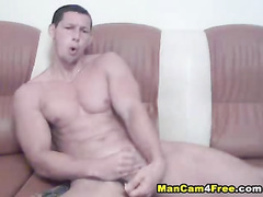 Strong gay is hotly posing and fucking with dildo