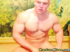 Rocky strong twink is hotly jerking off on gay porn