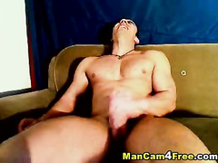 Sexy strong gay dude is hotly masturbating on couch