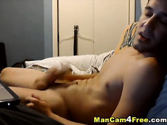 Skinny twink hotly jerking dick on the bed