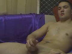 Young brunet twink is pleasantly masturbating cock