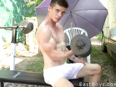 Nude amateur guy doing sports outdoor