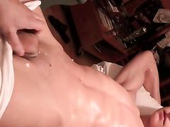 Gay guy masturbates his friend before camera