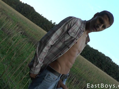 Young guy big cock masturbation in the field
