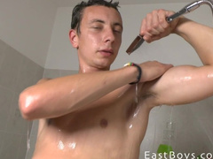 Gay washes and strokes his nice big cock